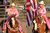 A whole lotta pink<br /> <br /> (Aug. 11, 2010) Another shot from the all girl's rodeo. I couldn't decide which one I liked better, so I combined them. The pink is part of rodeo's Tough Enough to Wear Pink campaign to raise breast cancer awareness. Also -- what's missing? The horse's bridle! This is one incredible team.